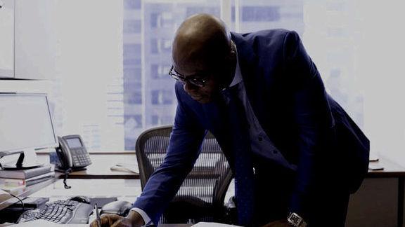 394-nm-businessman-reading-documents-697539185.v2.jpg